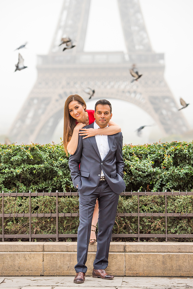 proposal in Paris with red dress and pigeons