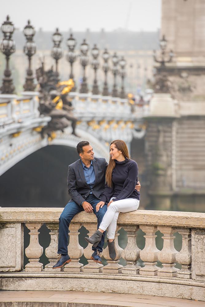 couple sitting on Alexandre 3 bridge Paris