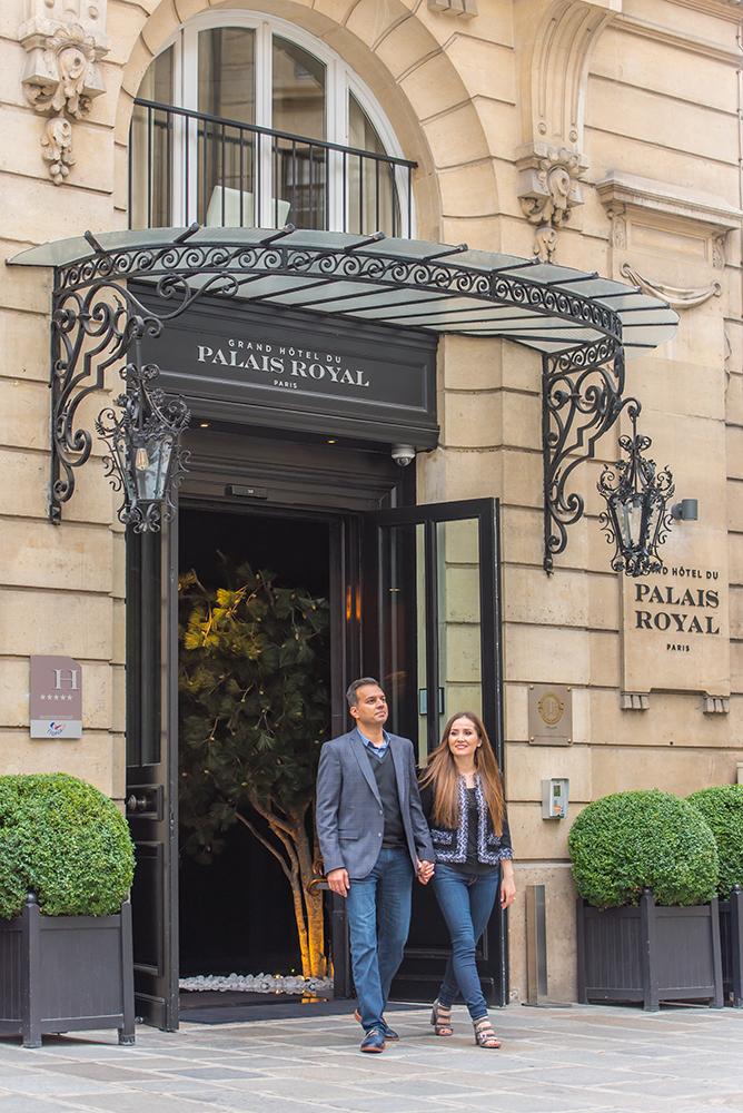 couple walking outside Palais Royal hotel