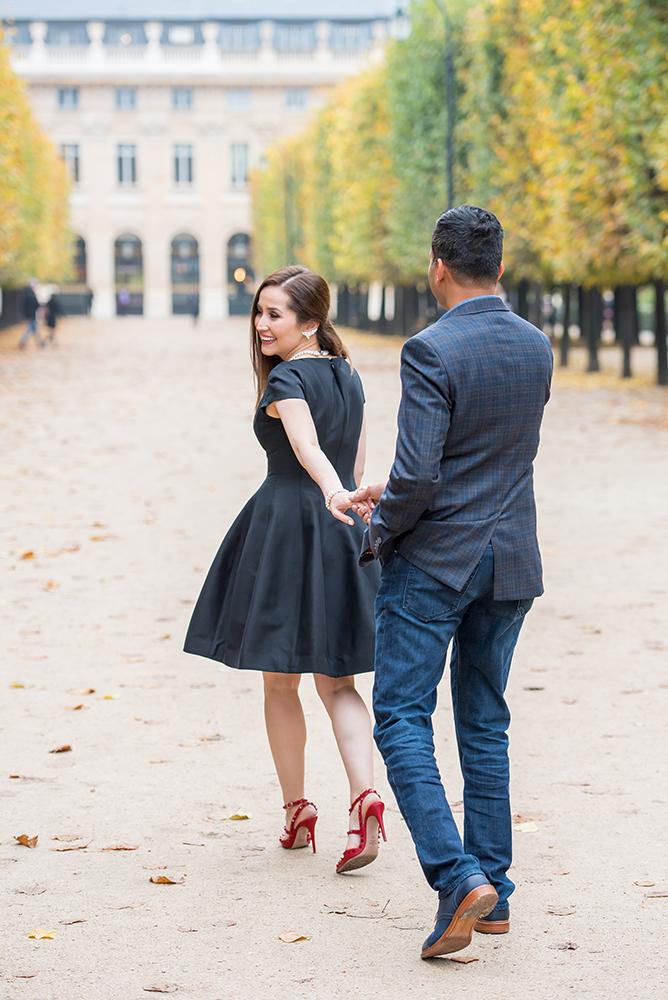 couple walking Palais Royal paris