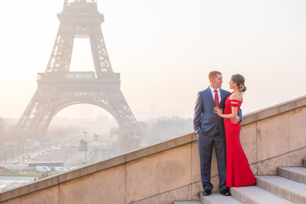 Couple photos during sunrise after proposal at Eiffel tower