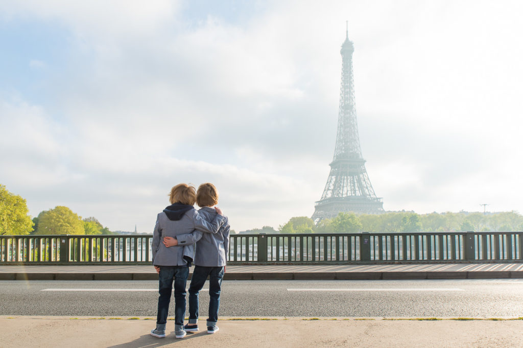 twins looking the Eiffel Tower