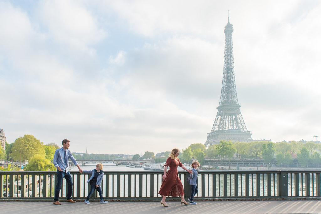 Family walking at Eiffel Tower on bridge near trocadero