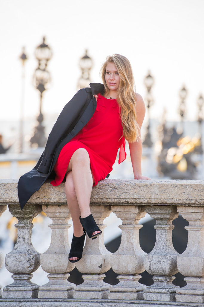Sweet sixteen photoshoot at bridge in Paris with red dress