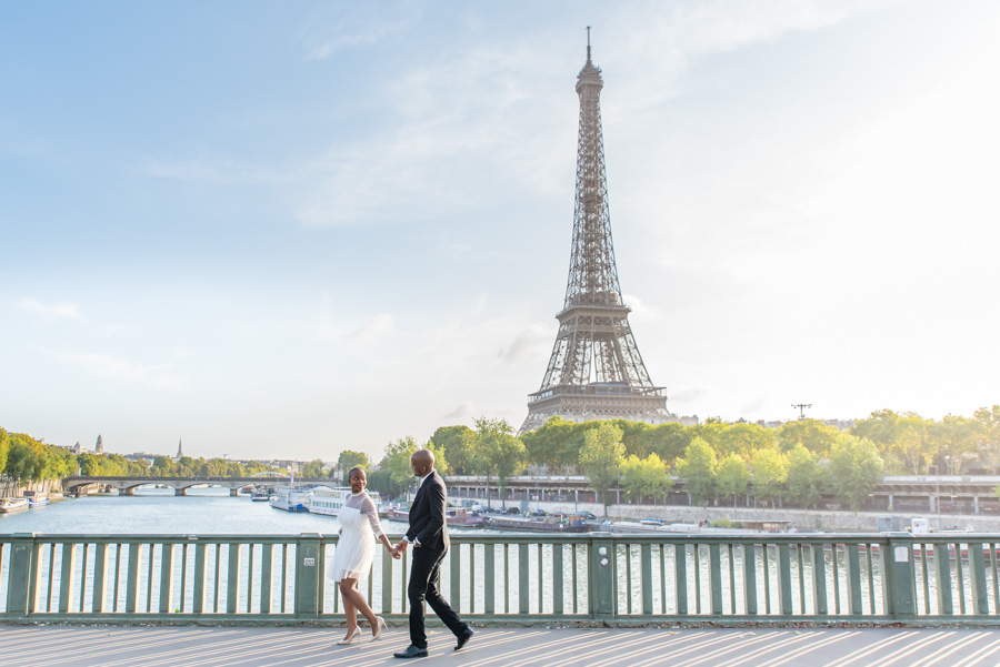Couple walking on bridge near Eiffel tower in paris