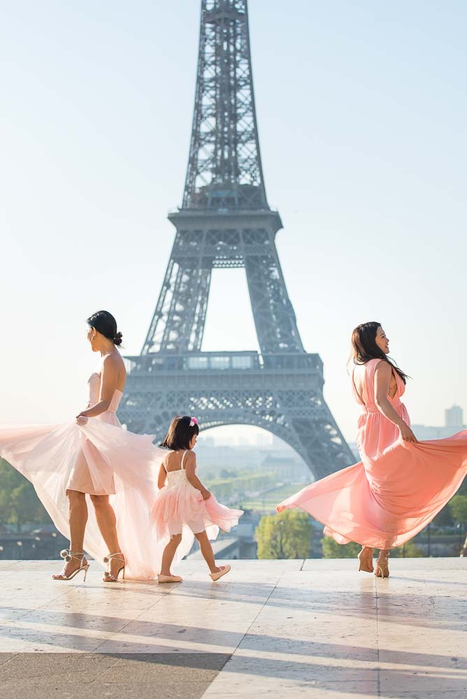 Girls dancing at the Eiffel Tower