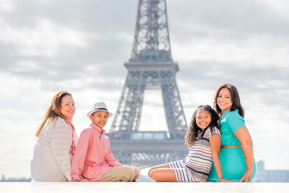 Kids photos sitting at the Eiffel Tower