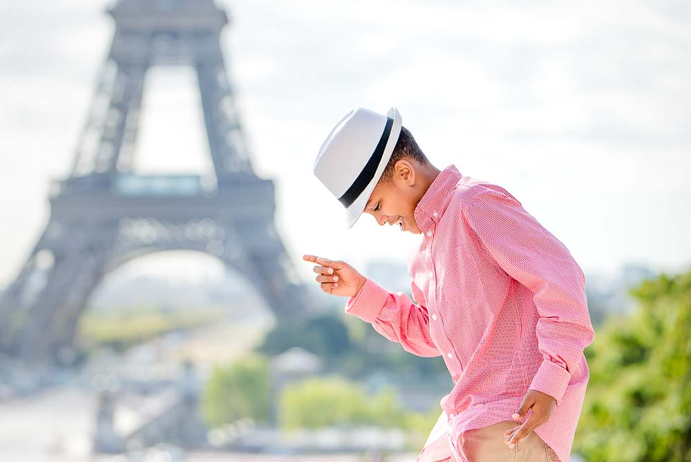 child dancing photo at the Eiffel Tower