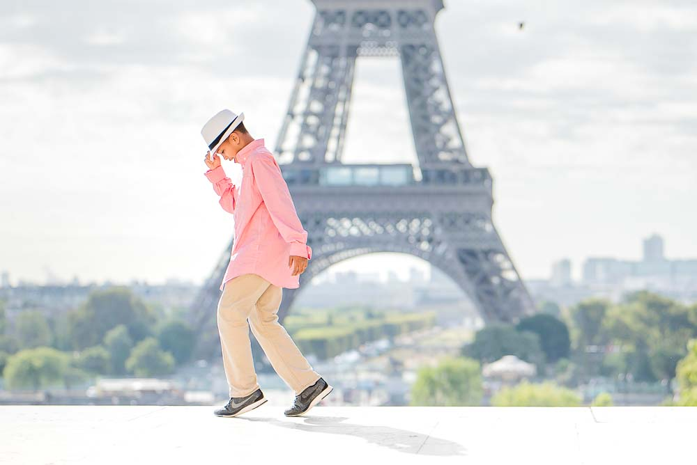 boy dancing photo at the Eiffel Tower