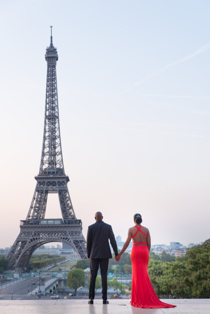 Couple looking at Eiffel Tower hand in hand