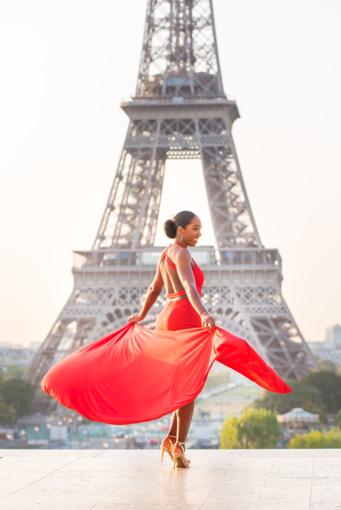Girl dancing at Eiffel Tower