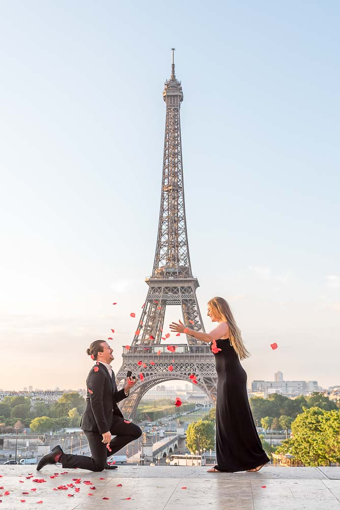Surprise Proposal at Eiffel Tower with flowers