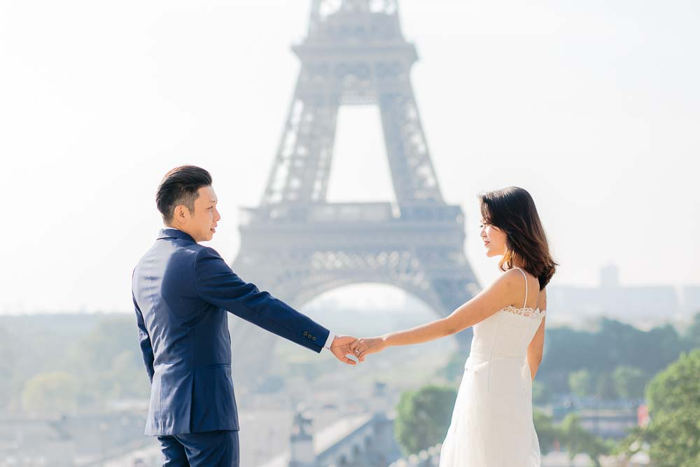 Couple holding hands in paris
