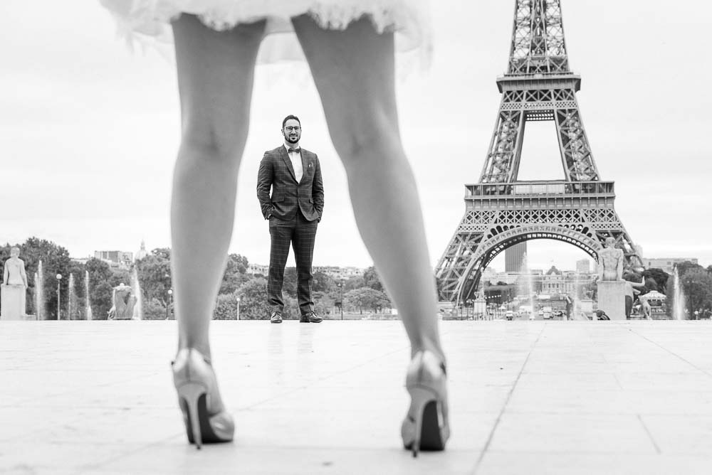 black and white engagement photo at Eiffel tower