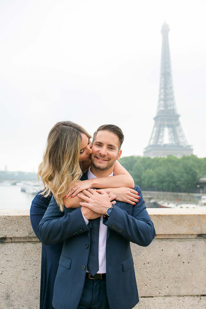 Romantic engagement picture at Eiffel Tower bridge