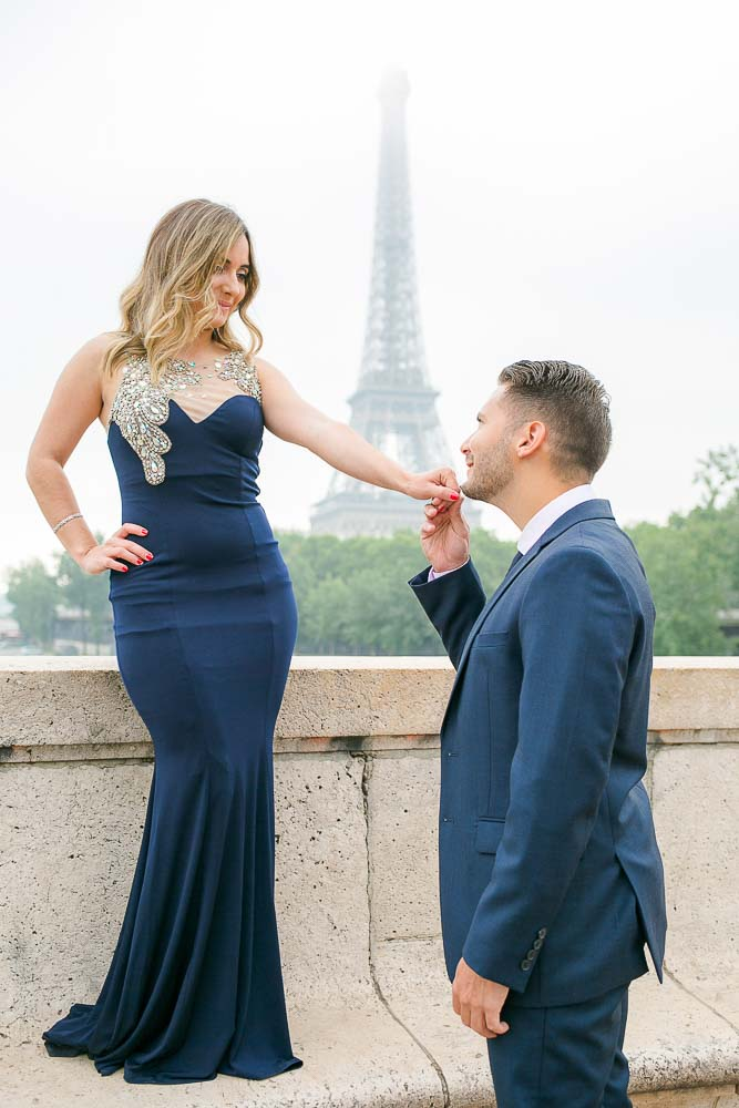 Romantic engagement photo at Eiffel Tower bridge