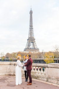 Ceremony near river with Eiffel Tower