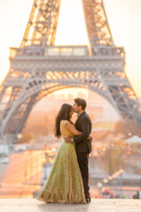 Kiss on Trocadero square with Eiffel Tower sunrise in the background