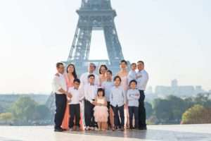 Big family photoshoot at the Eiffel Tower