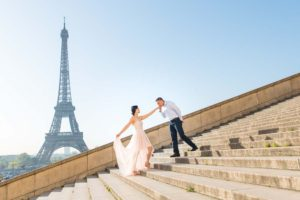 Couple on stairs during family photo session at Trocadero