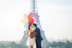 Surprise proposal at Eiffel Tower with balloons