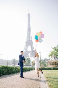 Surprise proposal with balloons and champagne iat Eiffel Tower
