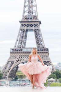 high-low pink dress in front of Eiffel tower
