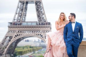 Couple at Eiffel Tower for a surprise engagement