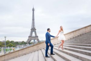 engaged Couple on stairs at Eiffel Tower