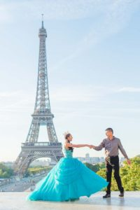 Quinceanera and father at Eiffel Tower